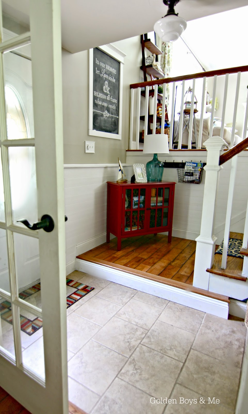 Tile in foyer with DIY stair runner-www.goldenboysandme.com