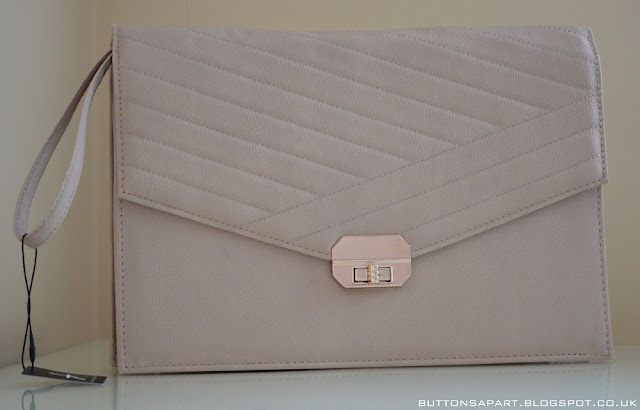 a picture of a blush clutch from primark