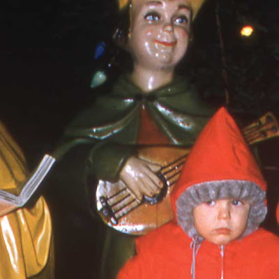 boy in front of Christmas decorations