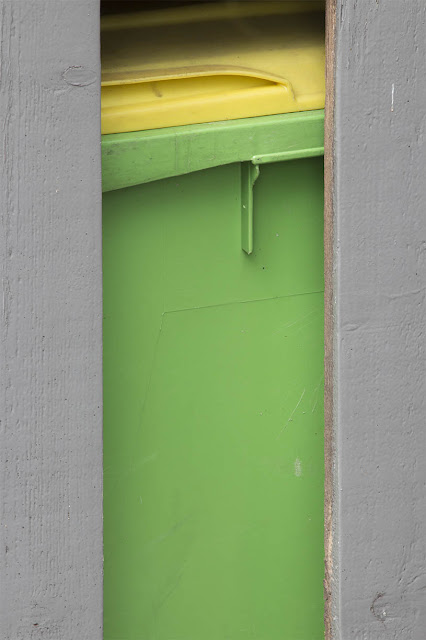 yellow and green trashcan