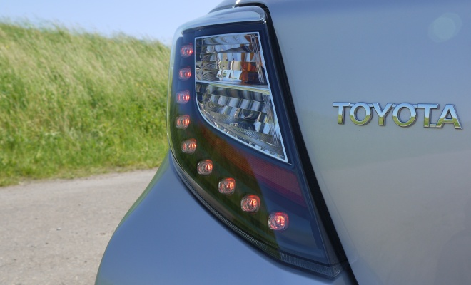 Rear lamp and Toyota badge of Yaris Hybrid