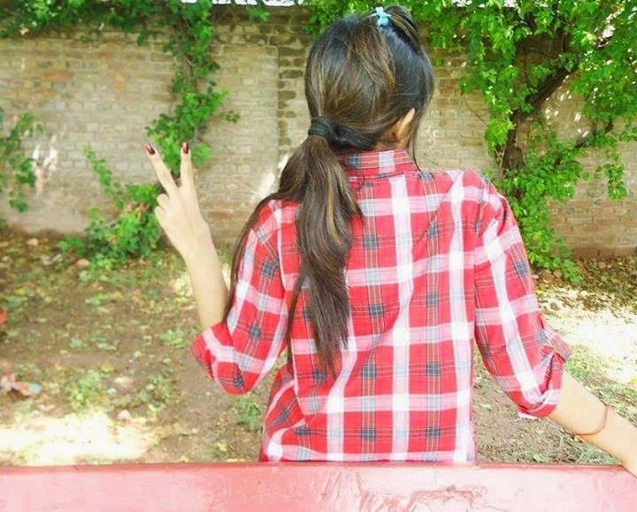 girl hide face fb dp in red check shirt