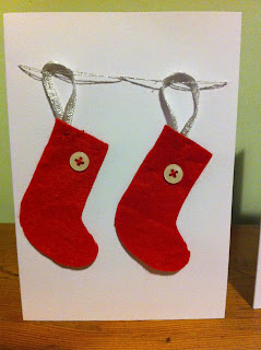 handmade christmas card with red felt stocking and white buttons