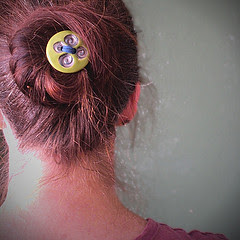 Porcelain button by VIKA, used as a hair fastener.