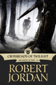 Cover of Crossroads of Twilight, featuring a person walking away from a tree with a battle ax lodged in its trunk.
