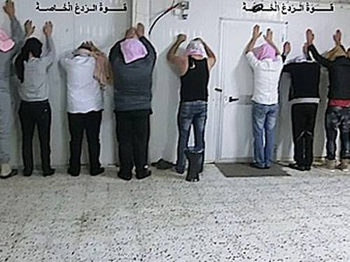 Foto de homens detidos por milícia líbia na semana passada (Foto: Facebook da milícia Nawasi/Lybia Herald)
