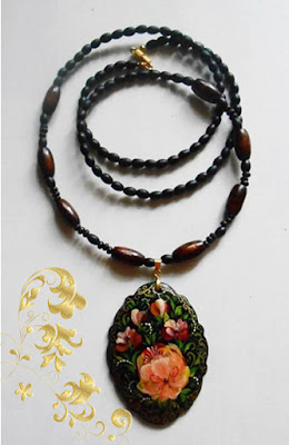 Pendant in the the Russian folk style in handmade Volkhovskaya on a Cord from wooden beads.
