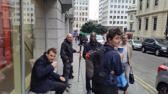 Photographers wait outside Charing Cross station for Alison Madueke.