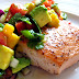 Salmon with avocado sauce and tangerine