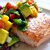 Salmon with avocado sauce and tangerine