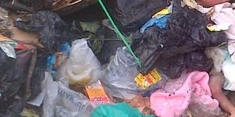 Heartbreaking: Have You Seen The Pictures Of Baby Abandoned At Refuse Heap In Akwa Ibom?