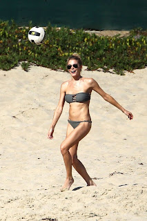 LeAnn Rimes wearing a two piece swimsuit and sunglasses