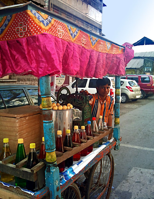 Boy vendor selling synthetic drinks