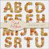 Alfabetos de verano hechos de conchas y caracoles