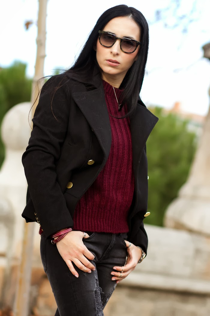 Oxblood sweater and black military coat