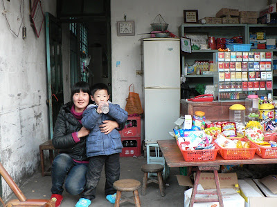 lady with young child in a small convenience store