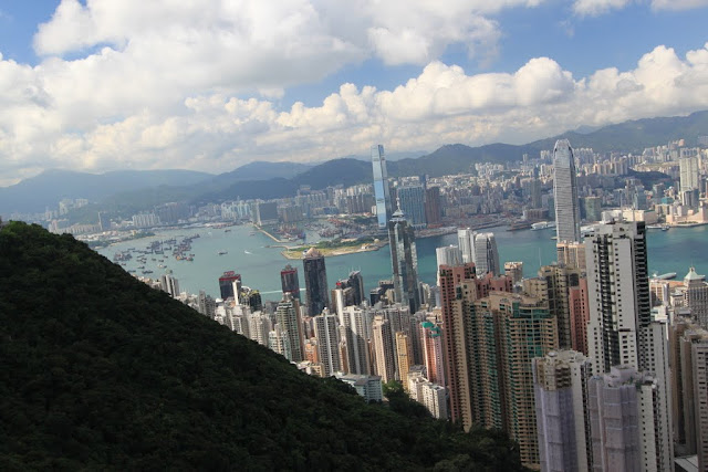 The corner view of skyline buildings from Sky Terrance 428 of The Peak Tram in Hong Kong