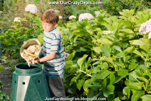 Young Boy Emptying Composting Bucket of Scraps into Green Homemade Compost Bin Picture