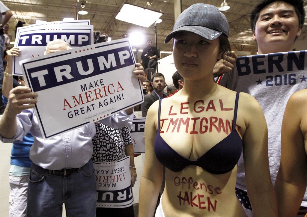 70 Of The Most Touching Photos Taken In 2015 - A protester stands outside a Donald Trump rally in Norcross, Georgia.