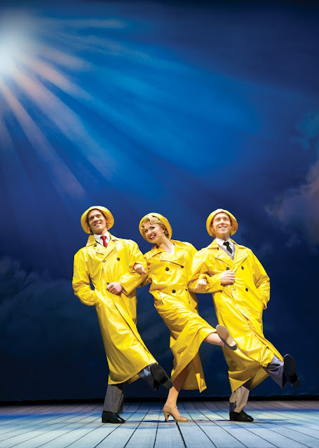 Singin in the rain in yellow raincoats on the stage in London