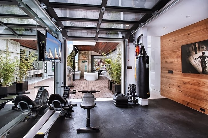 Home gym in Incredible 604 Acacia House by Brandon Architects