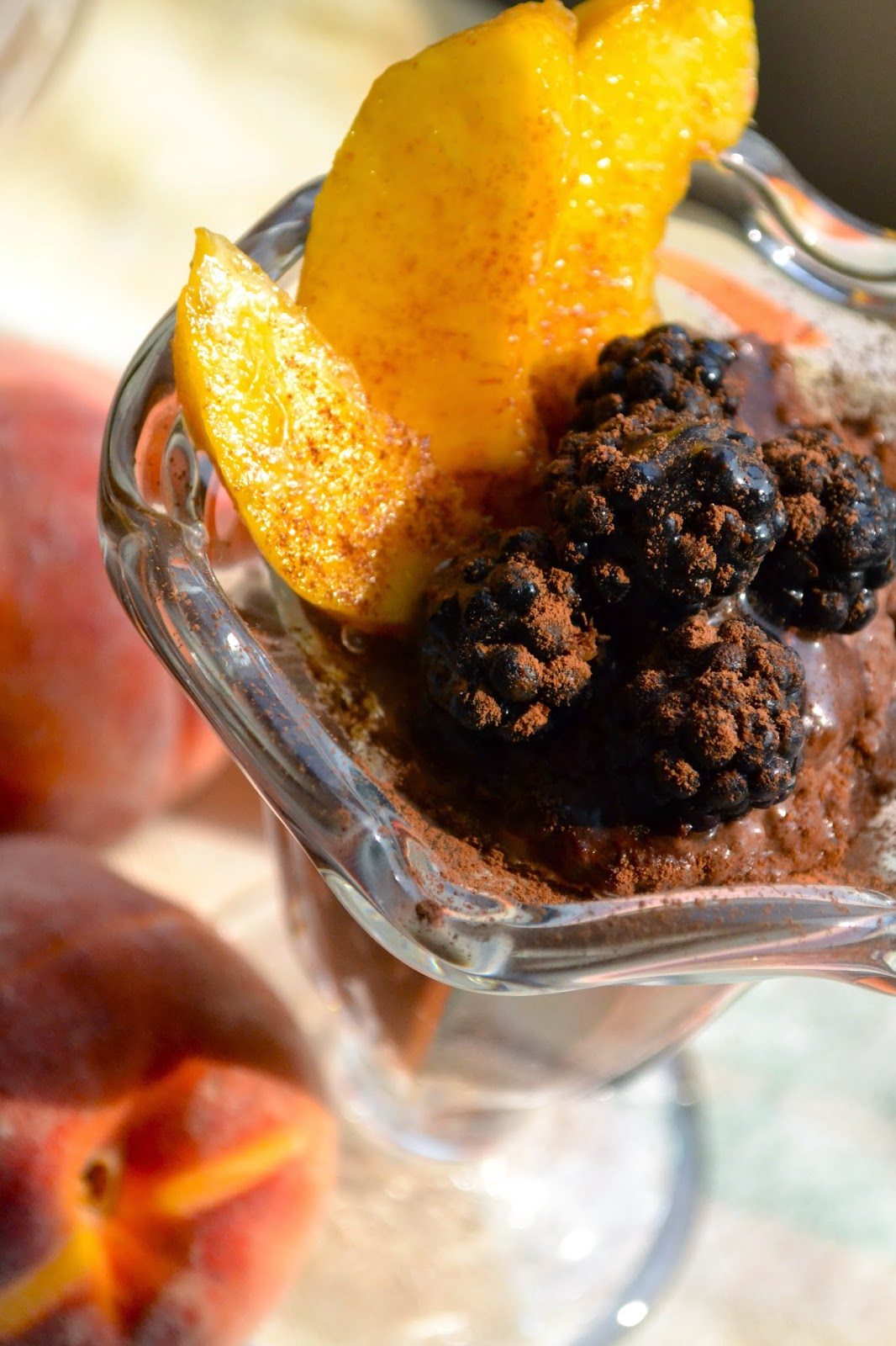 chocolate chia pudding with blackberries and peaches
