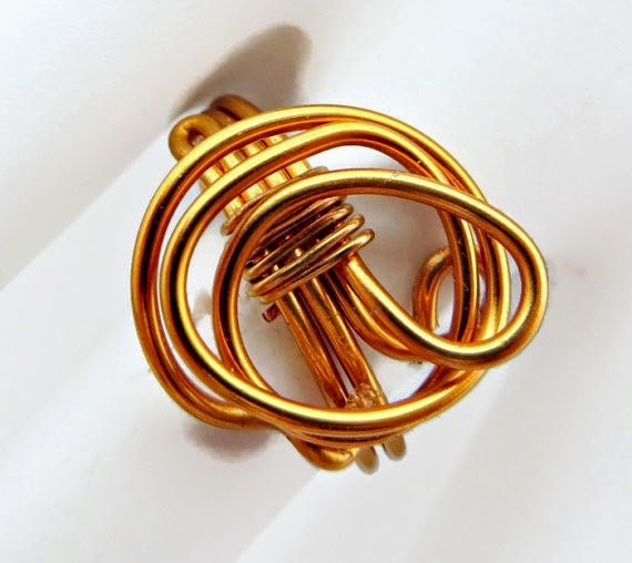 https://www.etsy.com/listing/195539694/free-form-golden-orange-wire-wrapped?ref=shop_home_active_23