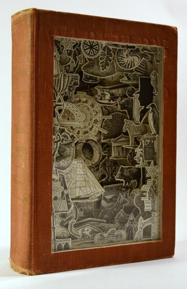 Booklicious julia feld s carved book art