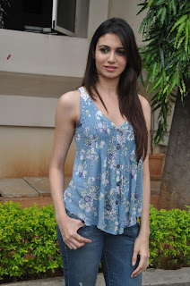 Simran Kaur in a loose Tank Top and Denim Jeans Pictures