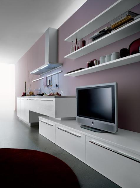 Cuisine design blanche faisant la jonction du salon, espace design ou appartement une pièce - cuisiniste montpellier