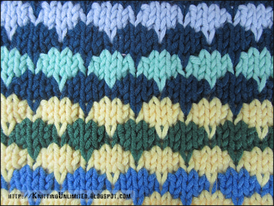 The multi-color pattern is a combination of knits, purls, and dip stitches.