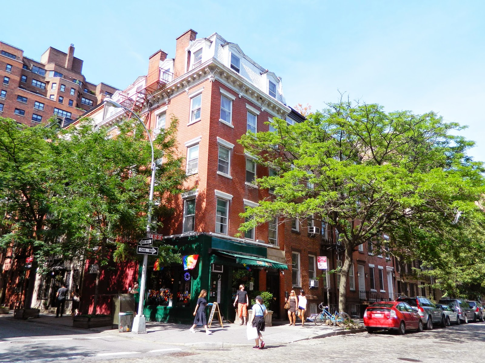 new york city chelsea beautiful streets brown house tree lined shops