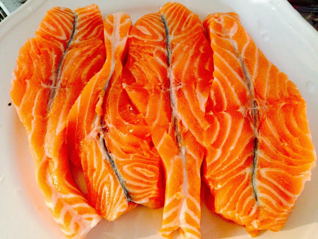 Raw salmon fillet cut into butterflies