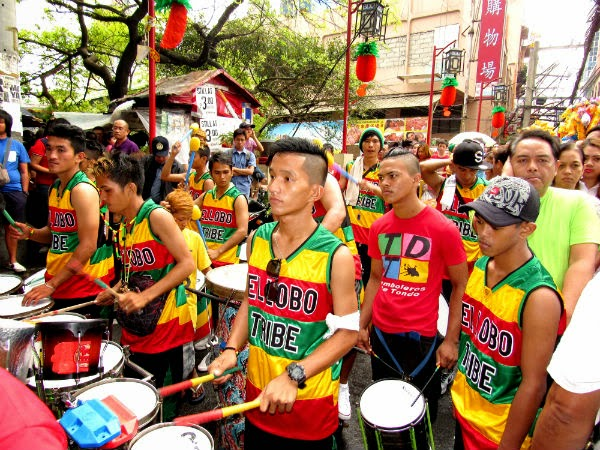 Chinatown: A marching band entertain the crowd along Ongpin St