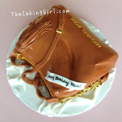 beige michael kors purse cake