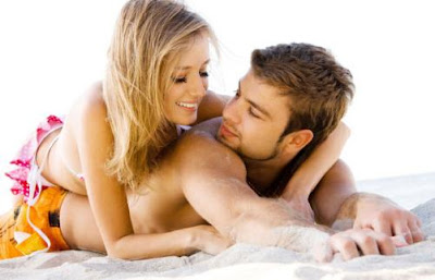 Fling Season - man and woman on beach flirting hugging