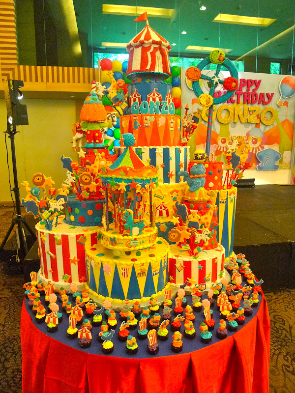 Nikkis Nurturance A Towering Carnival Cake And Custom Crafted