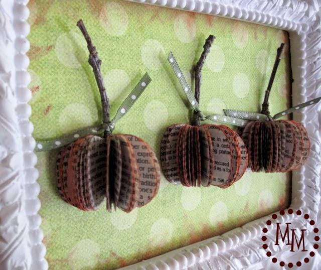 http://www.thescrapshoppeblog.com/2011/10/framed-book-page-pumpkins.html