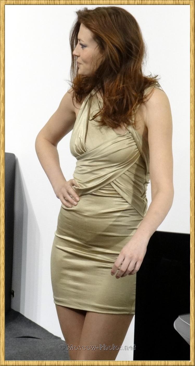 Model In Shiny Tight Mini Dress