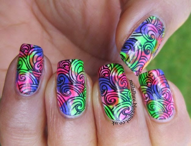 Swirly stamping on a multi-coloured neon base