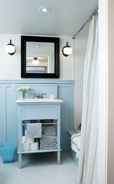 The cute little blue vanity above is actually an inexpensive vanity