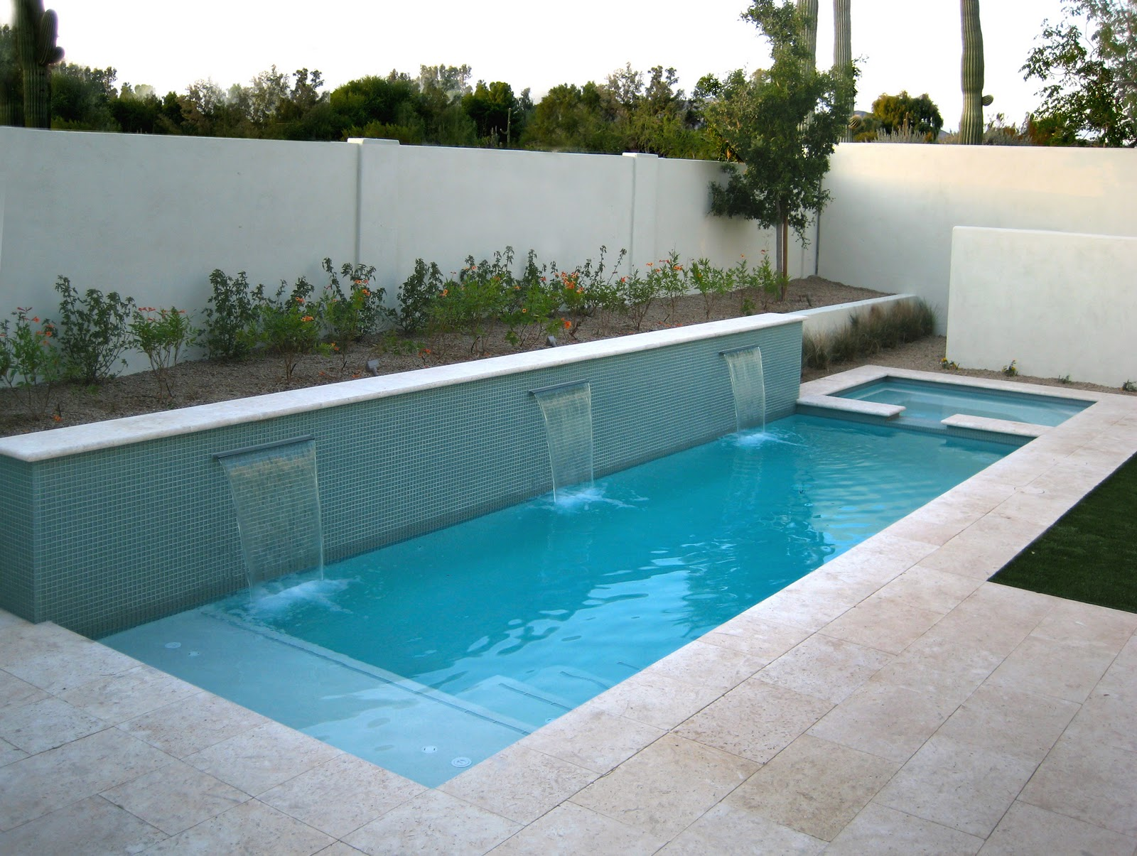 Swimming pools in small spaces alpentile glass tile for Small backyard swimming pool designs