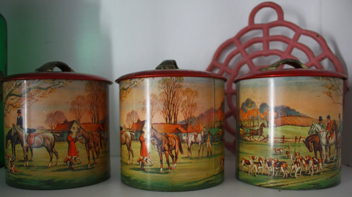 vintage canisters with hunt scenes