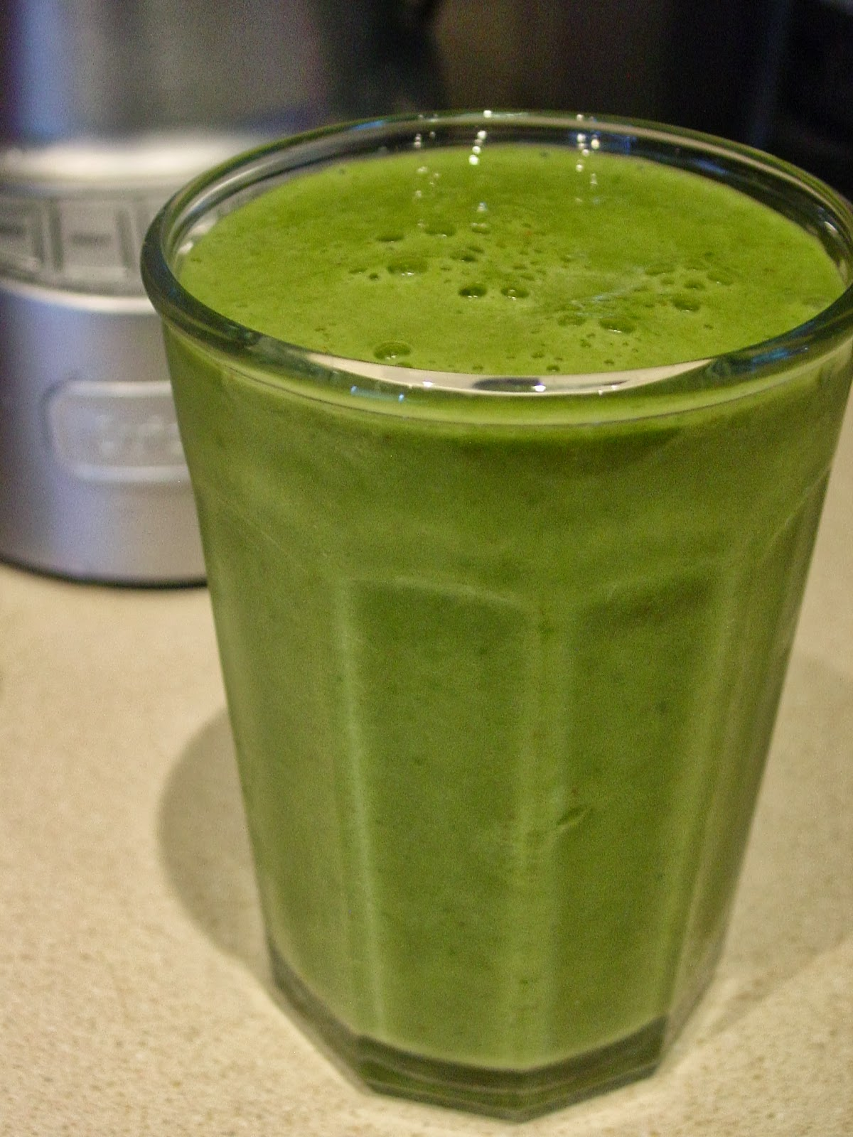 green fruit with seeds fruit and spinach smoothie