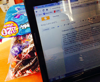 Bags of candy behind laptop