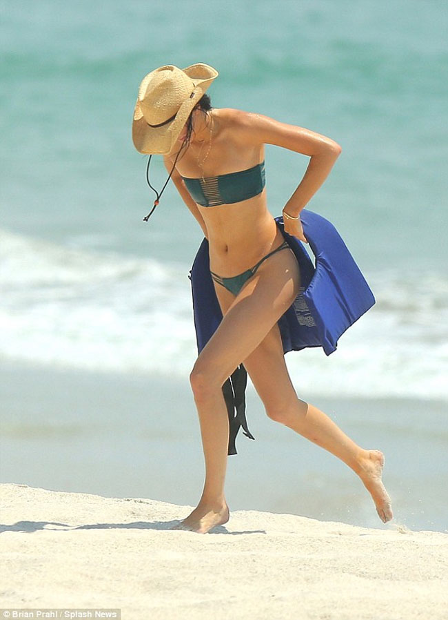 Kendall Jenner on the sand beach in green bikini