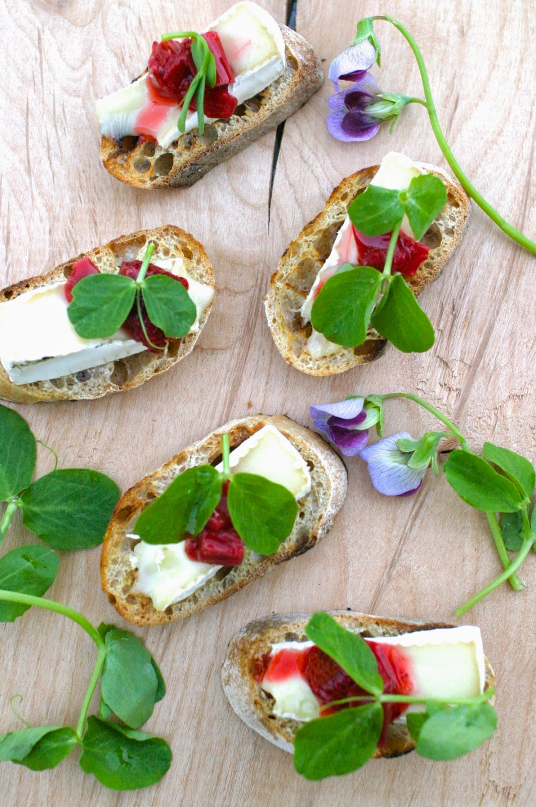 All Our Fingers in the Pie: Pea Shoot Topped Crostini