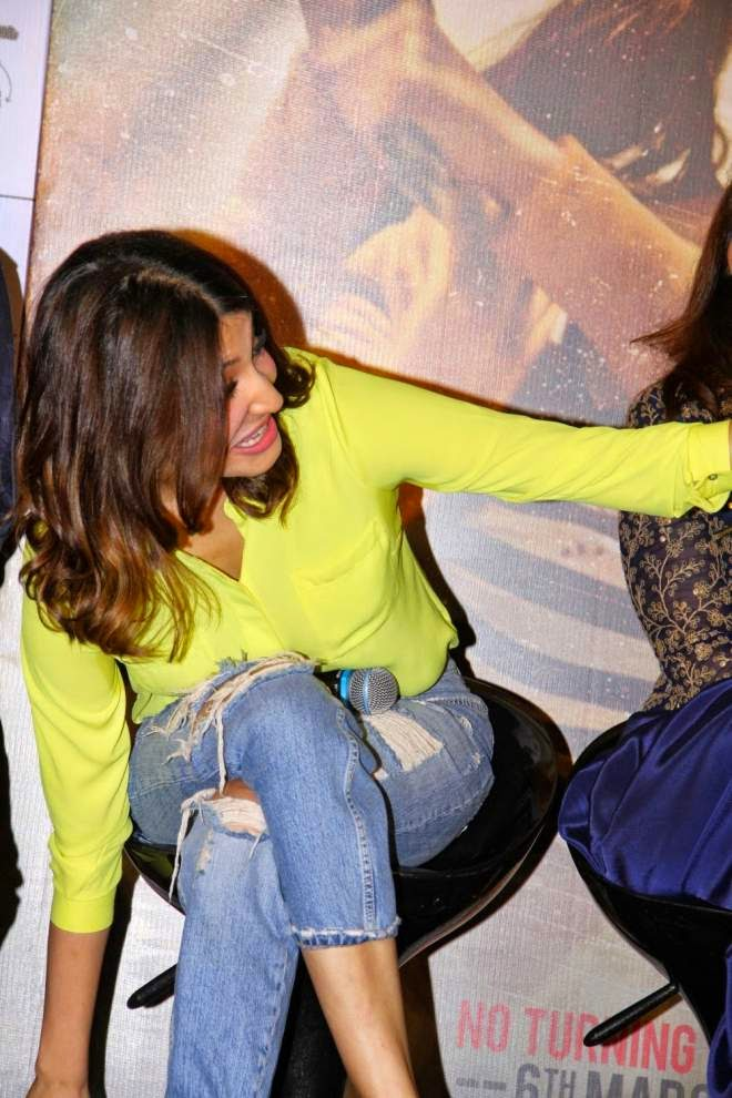 Anushka Sharma Yellow Top and Ripped Jeans Photos