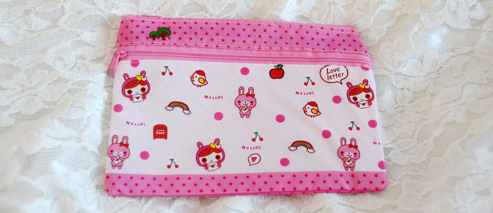 The kawaii pink zippered pouch with a girl and her bunny, from Blippo.
