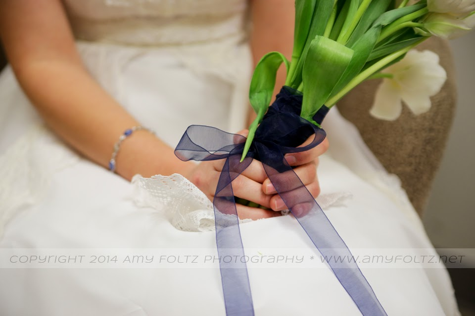 photo of a bride's bouquet with a handmade handkerchief